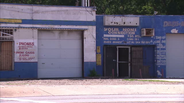 exterior shots rundown shops and buildings with rubbish dumped at side of the road in dixon circle neighbourhood. on july 10, 2016 in dallas, texas. - recession stock videos & royalty-free footage