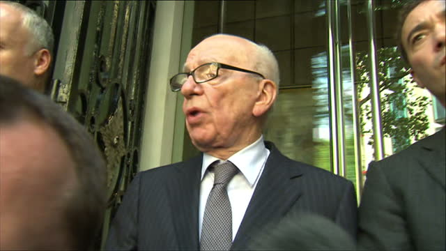 exterior shots rupert murdoch makes statement to the press from the steps of hotel offering a full apology for the actions of news of the world... - politics stock videos & royalty-free footage