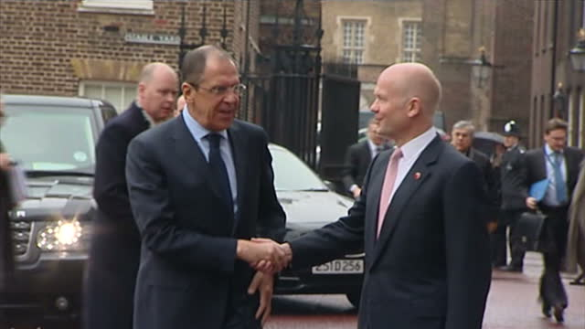 exterior shots russian foreign minister sergey lavrov arrives & is greeted by british foreign secretary william hague with both men posing for photo... - photo call stock videos & royalty-free footage