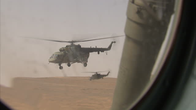 exterior shots russian military helicopters flying low over territory supposedly held by the syrian government on their way to the ancient city of... - army soldier stock videos & royalty-free footage