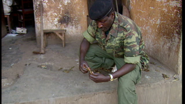 exterior shots rwandan soldier loading fresh bullets into cartridge case on june 16 1994 in various cities rwanda - völkermord stock-videos und b-roll-filmmaterial