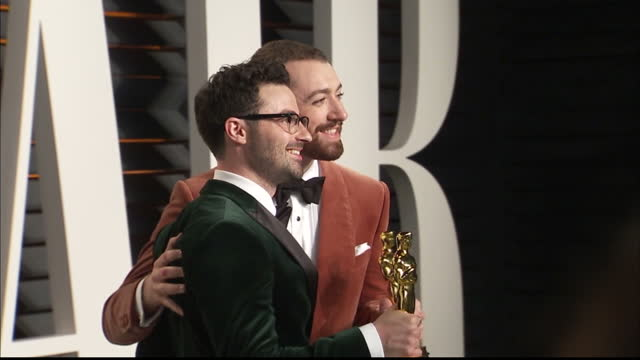 Exterior shots Sam Smith Jimmy Napeson on Vanity Fair red carpet holding Academy Awards for Best Original Song and pose for photographers on February...