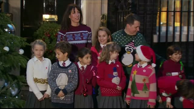 exterior shots samantha cameron poses with a group of children all wearing christmas jumpers ouside number 10 downing street mrs cameron who is a... - save the children stock videos & royalty-free footage