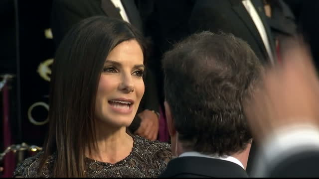 Exterior shots Sandra Bullock chats to reporters on the red carpet Sandra Bullock on the Red Carpet at Dolby Theatre on February 25 2013 in Hollywood...