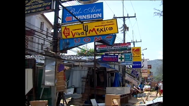 exterior shots scenes of destruction in phuket in the aftermath of the tsunami with people and rescue workers trying to recover damaged vehicles... - indian ocean stock videos & royalty-free footage