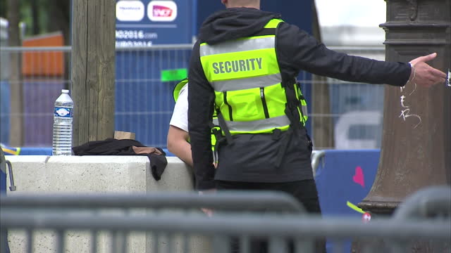 exterior shots security guards standing at entrance to euro 2016 fan zone on june 08 2016 in paris france - 警備員点の映像素材/bロール