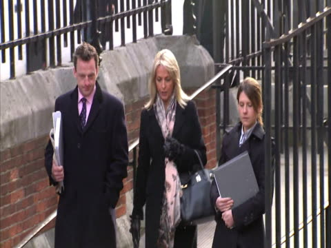 exterior shots sheryl gascoigne former wife of footballer paul gascoigne arrives at the royal courts of justice to give evidence at the leveson... - sheryl gascoigne stock videos and b-roll footage