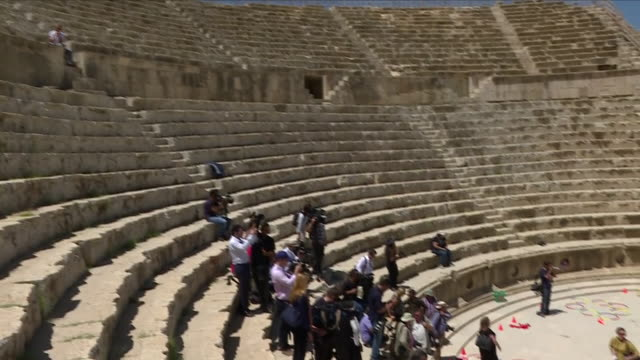exterior shots show prince william duke of cambridge visiting the amphitheatre part of the archaeological site of jerash including press taking... - amphitheatre stock videos & royalty-free footage