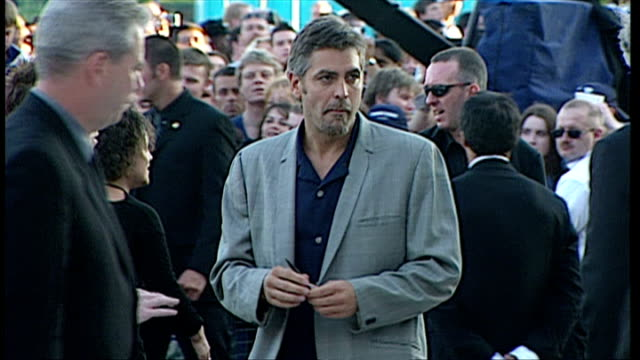 Exterior shots showing actor George Clooney arriving on red carpet for premiere of movie The Perfect Storm on July 20 2000 in Birmingham United...