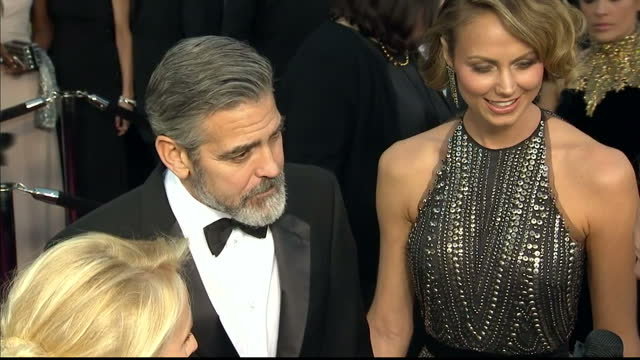 exterior shots showing actor george clooney on the oscars red carpet talking to the media with former partner stacy keibler. on february 25, 2013 in... - ジョージ・クルーニー点の映像素材/bロール