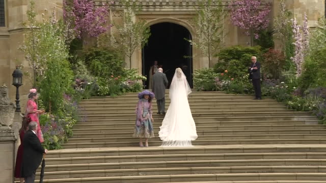 exterior shots showing lady gabriella windsor accompanied by her father prince michael of kent as she climbs steps to st george's chapel ahead of... - st. george's chapel stock videos & royalty-free footage