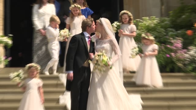 exterior shots showing lady gabriella windsor and thomas kingston sharing a kiss on the steps of st george's chapel after their wedding ceremony... - st. george's chapel stock videos & royalty-free footage