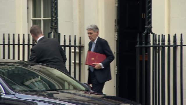 exterior shots showing philip hammond chancellor of the exchequer departing 11 downing street carrying official red briefcase on 17 december 2018 in... - briefcase stock videos & royalty-free footage