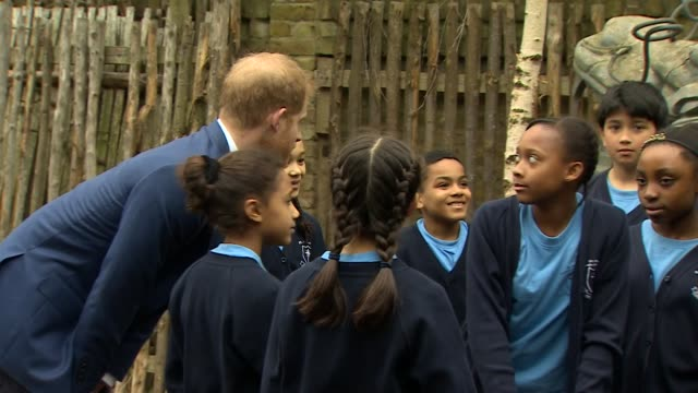 Exterior shots showing Prince Harry Duke of Sussex chatting to students during his visit to St Vincent's Catholic Primary School on March 20 2019 in...