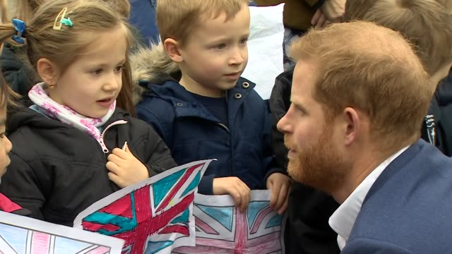 Exterior shots showing Prince Harry Duke of Sussex chatting to little primary school children during his visit to St Vincent's Catholic Primary...