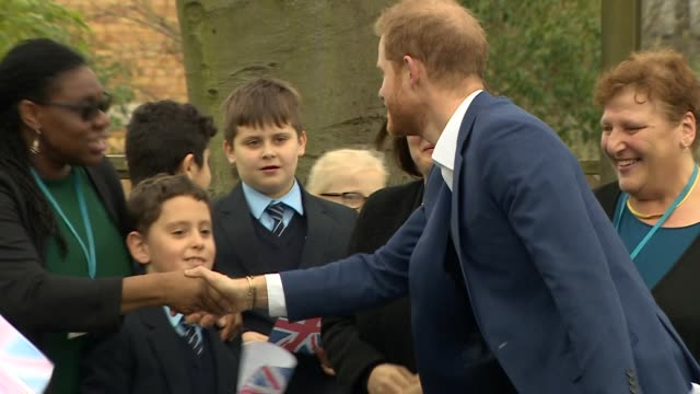 Exterior shots showing Prince Harry Duke of Sussex chatting to primary school children during his visit to St Vincent's Catholic Primary School on...