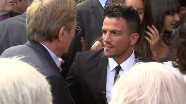 exterior shots sir tim rice chats with nicolas parsons exterior shots peter andre chats with people in the crowd celebrities at robin gibb blue... - tim rice stock videos and b-roll footage