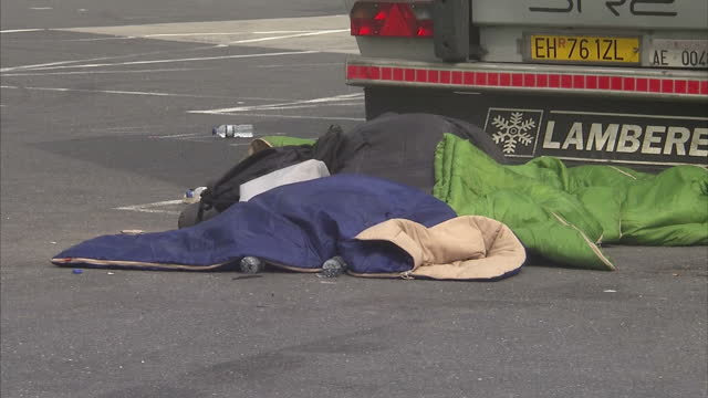 exterior shots sleeping bags lying at rear of parked lorry with police car parked next to them on august 28 2015 in cobham england - human trafficking stock videos & royalty-free footage