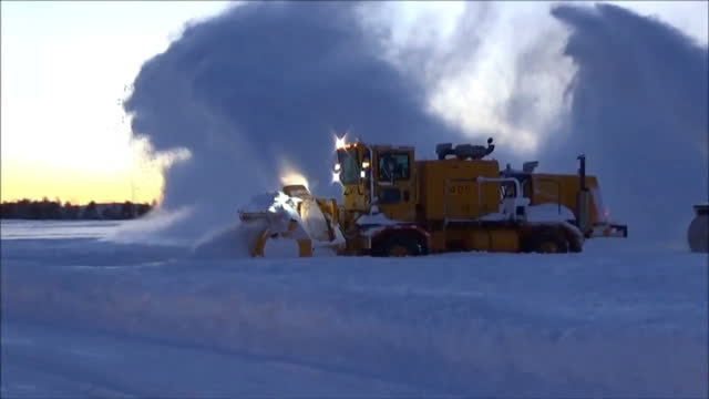 exterior shots snow clearing machines clearing snow from the runways at washington dulles international airport after winter storm jonas hit the us... - dulles international airport stock videos and b-roll footage