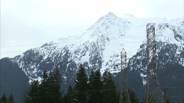 exterior shots snow covered mountains and evergreen forests on 27th march 2014 in oso washington state united states - oso washington stock videos & royalty-free footage