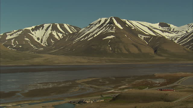 exterior shots snow covered mountains surrounding the town of longyearbyen in the administrative centre of svalbard on july 12 2016 in longyearbyen... - svalbard and jan mayen stock videos & royalty-free footage