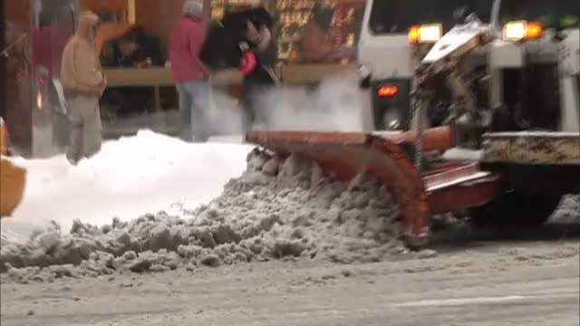 exterior shots snow plough clearing snow and slush from road in central manhattan with new york yellow taxi cabs driving past on february 13 2014 in... - slush stock videos and b-roll footage