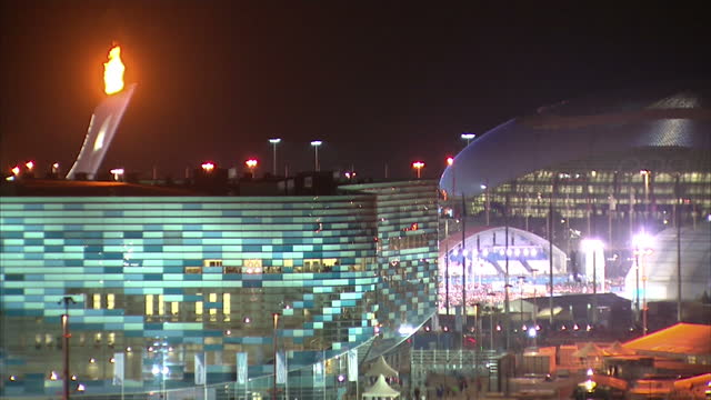 vídeos y material grabado en eventos de stock de exterior shots sochi olympic park at night with colourful light display on roof of bolshoy ice dome on in sochi russia - sochi