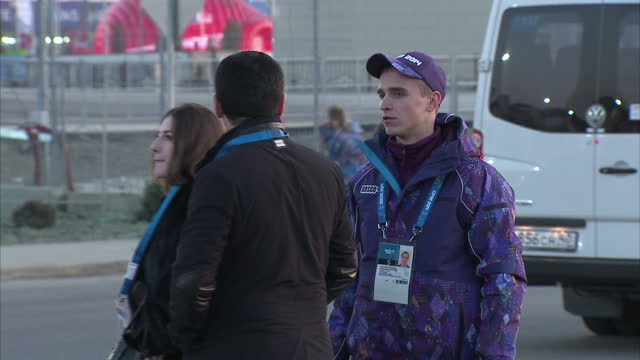 exterior shots sochi olympic volunteer's directing people and traffic arriving at the olympic park on in sochi russia - directing stock videos and b-roll footage
