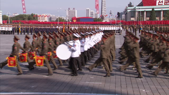 exterior shots soldiers in military band carrying instruments and marching in synchronisation at workers party 70th anniversary military parade on... - korea bildbanksvideor och videomaterial från bakom kulisserna
