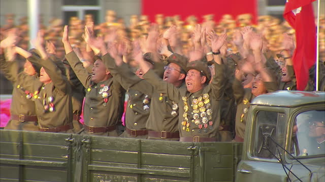 exterior shots soldiers in military uniform sitting in back of military vehicles waving to kim jongun north korean leader to show support at workers... - uniform stock videos & royalty-free footage