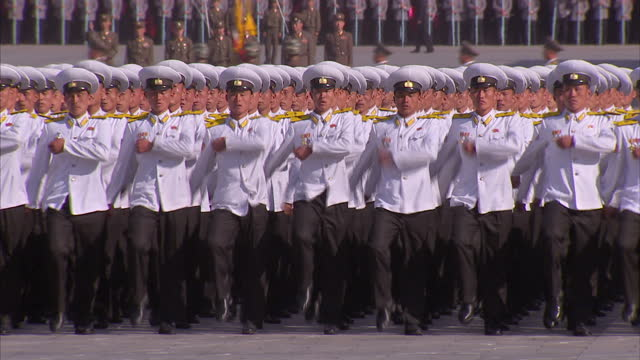 exterior shots soldiers in white military uniform marching in synchronisation at workers party 70th anniversary military parade on october 11 2015 in... - marching stock videos & royalty-free footage