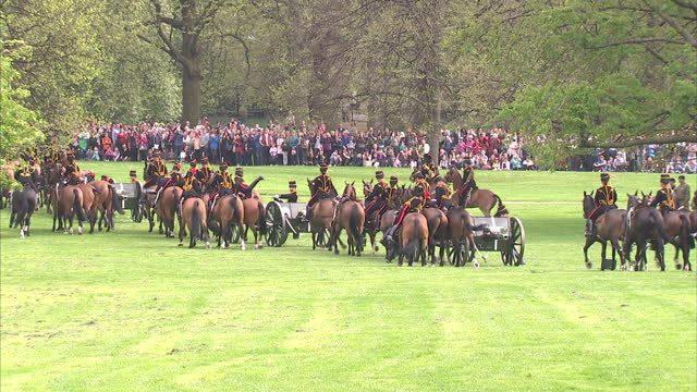 exterior shots soldiers marching on horseback through green park towing cannons for gun salutes the king's troop royal horse artillery set up guns... - royal horse artillery stock videos and b-roll footage