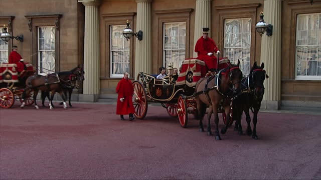 Exterior shots South Korean ambassador Sungnam Lim his wife arrive at Buckingham Palace in landau carriage are greeted by palace officials Queen...