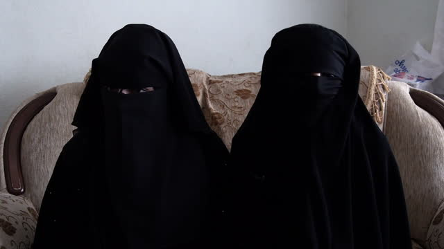 exterior shots southern turkey street scenes women wearing niqabs walking around market internal interview doa'a and umm ous former is women's police... - militant groups stock videos & royalty-free footage