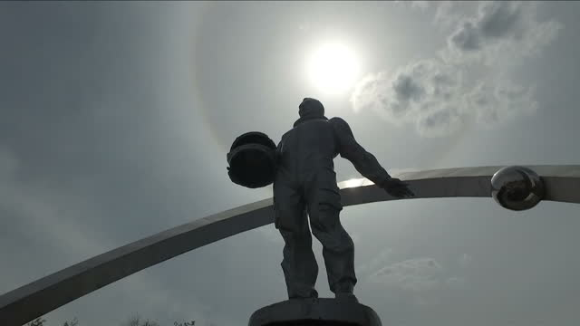 Exterior shots statue of Yuri Gagarin Russian Soviet astronaut and first human to journey into outer space in Karaganda town square on June 16 2016...