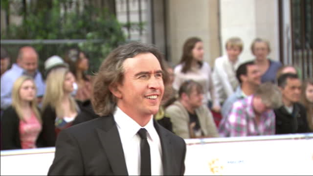 exterior shots steve coogan poses for the press on the red carpet. exterior shot steve coogan speaks to reporter bafta television awards red carpet... - steve coogan stock videos & royalty-free footage