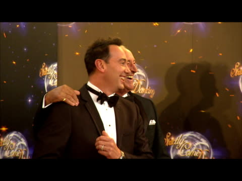 exterior shots strictly come dancing judges len goodman and craig revel horwood waltz on red carpet together and pose for photo opportunity. strictly... - ストリクトリーカムダンシング点の映像素材/bロール