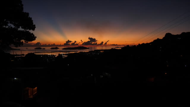 vídeos y material grabado en eventos de stock de exterior shots sunrise over victoria on february 14 2018 in port victoria seychelles - seychelles