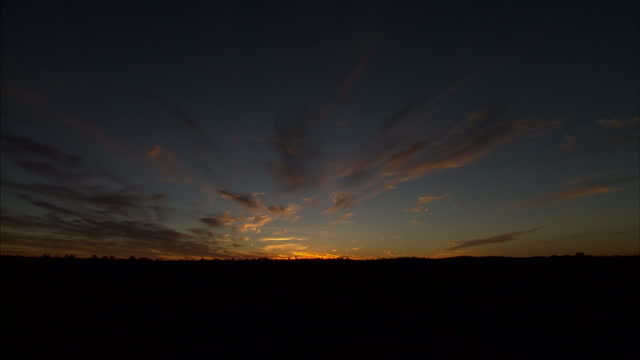 Exterior shots sunset timelapse over Ayers Rock on April 22 2014 in Australia