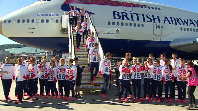 exterior shots team gb athletes walk down steps of british airways flight ba2016 after returning from the rio 2016 olympic games and pose for team... - team photo stock videos & royalty-free footage