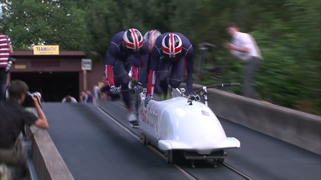 exterior shots team gb bobsleigh team practising in bath the team will be heading to the winter olympic games in sochi russia next february team gb... - bobsleighing stock videos & royalty-free footage
