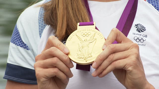 exterior shots team gb gold medal winning rower helen glover poses with her medal helen glover poses with her gold medal on august 01 2012 in london... - gold medal stock videos & royalty-free footage