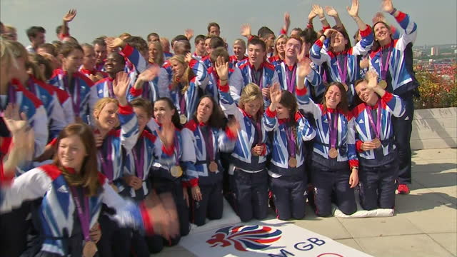 exterior shots team gb medal winners including rachel adams tom daley victoria pendleton gather for mass photo call on the roof of the westfield... - 2012年ロンドン夏季オリンピック点の映像素材/bロール