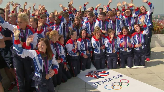 exterior shots team gb medal winners including rachel adams tom daley victoria pendleton gather for mass photo call on the roof of the westfield... - medal stock videos & royalty-free footage