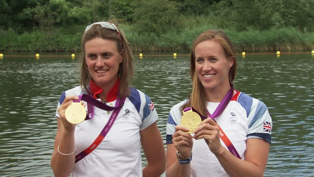exterior shots team gb's gold medal winning rowing pair helen glover heather stanning pose for the press with thier gold medals heather stanning... - helen glover rower stock videos and b-roll footage
