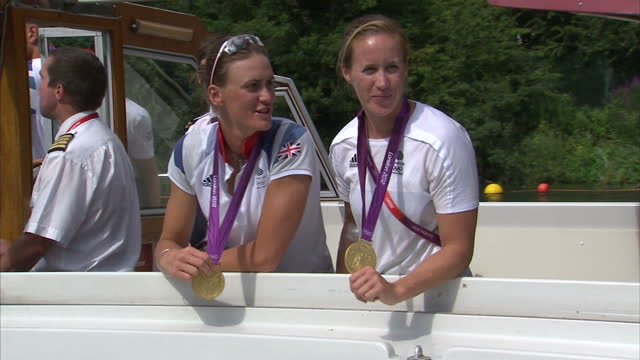 exterior shots team gb's women's gold medal winning rowing pair helen glover heather stanning pose for photo call on boat holding their gold medals... - helen glover rower stock videos and b-roll footage