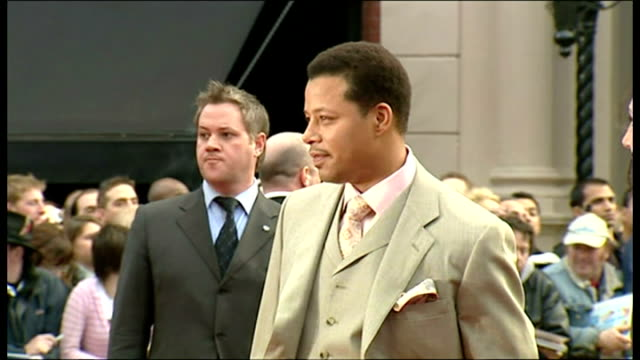 exterior shots terrence howard, actor, posing for photographs and talking to press on the red carpet for the premiere of iron man at the odeon... - terrence howard stock videos & royalty-free footage