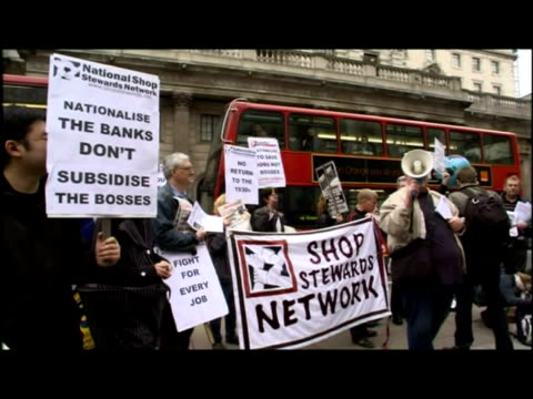 exterior shots the bank of england building, pan down to protesters. exterior shots shop stewards network protesters holding placards and banners.... - crisis stock videos & royalty-free footage