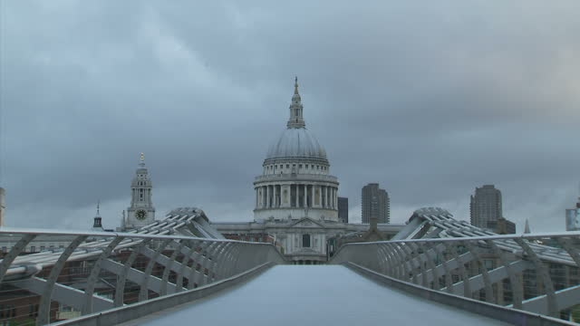 exterior shots the millennium bridge crossing the river thames with st paul's cathedral in the background on may 05 2015 in london england - london millennium footbridge stock videos & royalty-free footage
