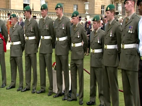 exterior shots the princess royal, princess anne greets & chats with a lineup of royal marines at a buckingham palace garden party princess anne... - royal marines stock videos & royalty-free footage